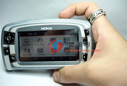 nokia 7710 held in hand